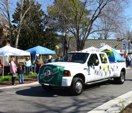 heralds: GLOUCESTER, VIRGINIA - APRIL 6: Yogi Bear camp resorts truck in the Daffodil Parade on April 6, 2013 in Gloucester, Virginia. In its 27th year, the parade heralds the arrival of spring. Editorial