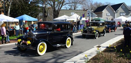 heralds: GLOUCESTER, VIRGINIA - APRIL 6: 1930 Ford Antique car in the Daffodil Parade on April 6, 2013 in Gloucester, Virginia. In its 27th year, the parade heralds the arrival of spring.