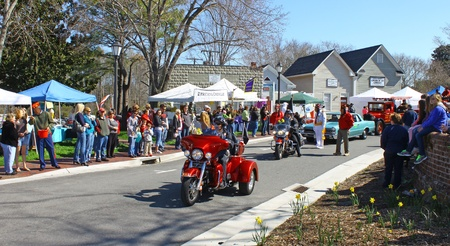 heralds: GLOUCESTER, VIRGINIA - APRIL 6: Hampton Roads Harley in the Daffodil Parade on April 6, 2013 in Gloucester, Virginia. In its 27th year, the parade heralds the arrival of spring.