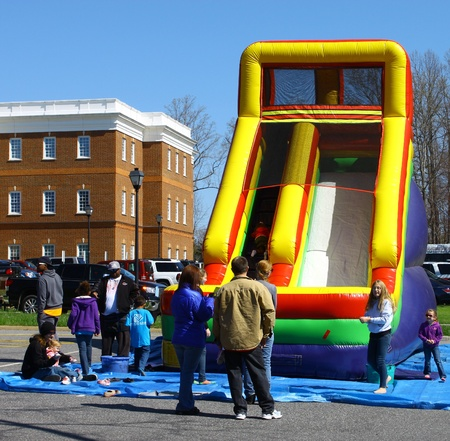 heralds: GLOUCESTER, VIRGINIA - APRIL 6: Inflateable Slide in the Daffodil Parade on April 6, 2013 in Gloucester, Virginia. In its 27th year, the parade heralds the arrival of spring. Editorial