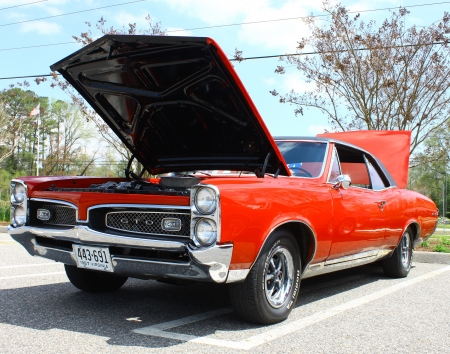 GLOUCESTER, VA- APRIL 13:67 Pontiac GTO in the Daffodil car show sponsored by the MPCC(middle peninsula car club)at the Main St shopping center in Gloucester, Virginia on April 13, 2013