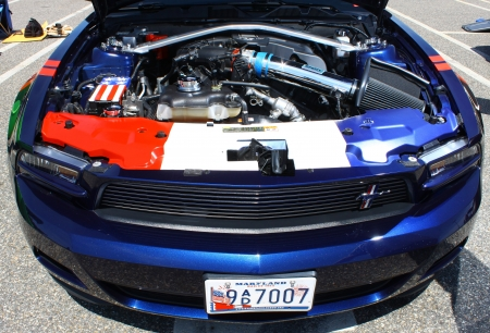 engine compartment: GLOUCESTER, VA- MAY 25: Ford Mustang engine compartment in the (middle peninsula car club) relay for life car show at the Main St shopping center in Gloucester, Virginia on May 25, 2013 Editorial