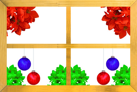 A Christmas design seen through a wooden window frame with red and green poinsettia flowers and  red and blue Christmas ball decorations on white  photo