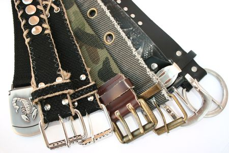 Fashionable belts isolated on the white for cool people. photo