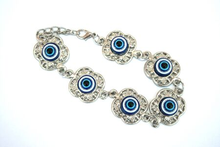 talisman: Metallic bracelet talisman with blue eyes for helping. Stock Photo
