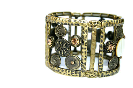 Metallic ancient style bracelet with ornaments and stones. photo