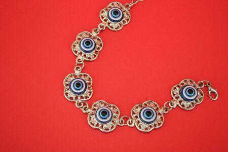 talisman: Metallic bracelet talisman with blue eyes for helping. Stock Photo