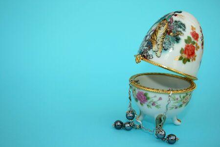 Nice jewellery box and beautiful gray necklace. photo