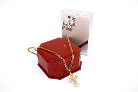 Golden cross and chain and two jewelery boxes. photo