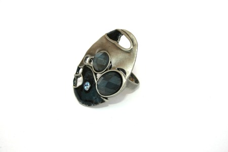 Silver ring with blue stones on the white. photo