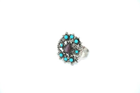Silver ring with nine stones isolated on the white. photo