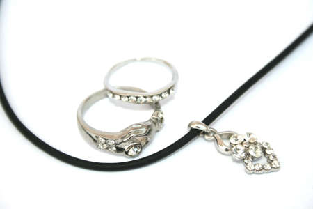 line lines luxury meeting: Two rings and necklace isolated on the white. Stock Photo
