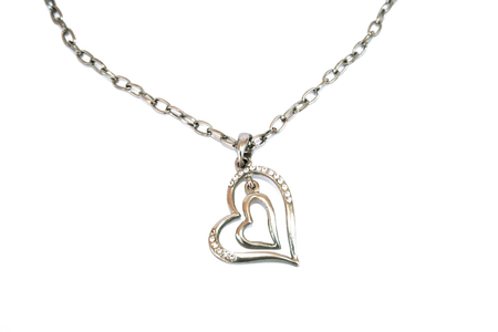 line lines luxury meeting: Two hearts with stones and necklace isolated on the white. Stock Photo