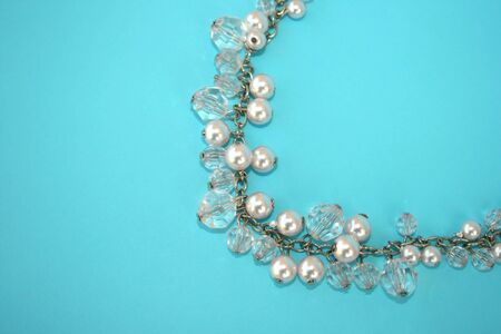 perls: Beautiful necklace with perls isolated on the blue.