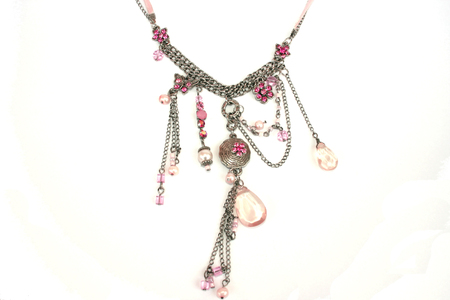 silvery: Nice necklace with different stones isolated on the white.