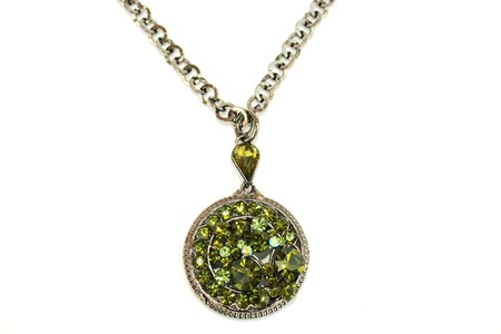 line lines luxury meeting: Wonderful necklace with green stones isolated on the white.