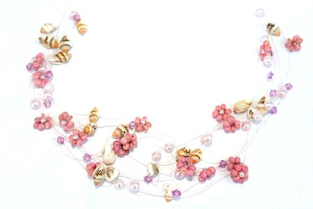 Wonderful necklace with pink flowers and sea-shells. photo