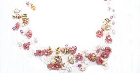 Wonderful necklace with flowers and sea-shells. Stock Photo - 1398677