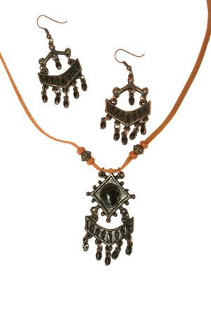 Brown necklace and earrings isolated on the white. Stock Photo - 1398660