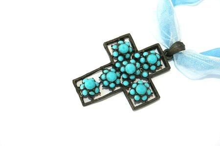 line lines luxury meeting: Metallic cross with blue stones and ribbons on the white.