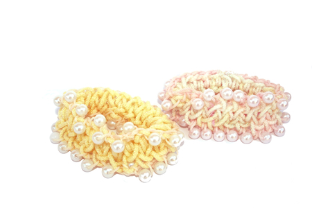 perls: Hair elastics with perls isolated on the white.
