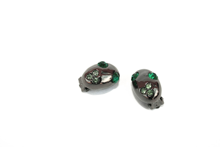 line lines luxury meeting: Black and green earrings isolated on the white.
