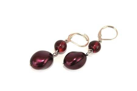 Maroon nice earrings isolated on the white. Stock Photo - 1511129
