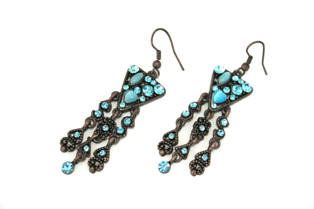 Nice earrings with blue stones isolated on the white. photo