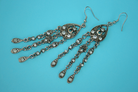 Nice silvery earrings isolated on the white. Stock Photo - 1511173