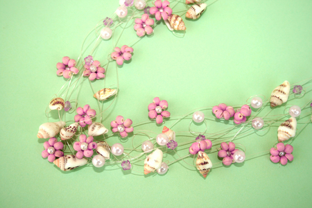 Wonderful necklace with pink flowers and sea-shells. Stock Photo - 1511178