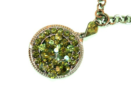 Wonderful necklace with green stones isolated on the white. photo