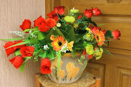 Many beautiful fabric flowers in the vase. Stock Photo - 1565265