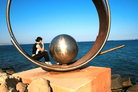 The Earth,girl and a sea together.