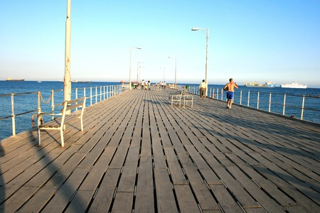People on the pier at the sea. photo