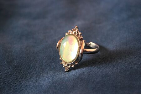 Nice ring with colorful stone on the gray. Stock Photo - 1647063
