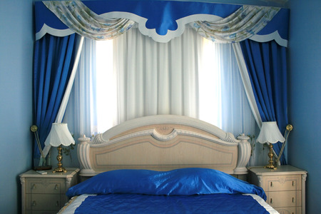 Nice blue bedroom with many luxurious details. Stock Photo - 1675505