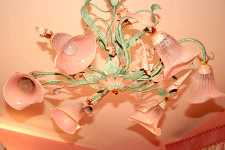 Luxurious pink and green chandelier in the bedroom. photo