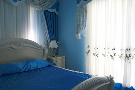 Nice blue bedroom with many luxurious details. photo