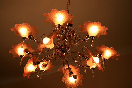Luxurious elegant chandelier in the living room. photo