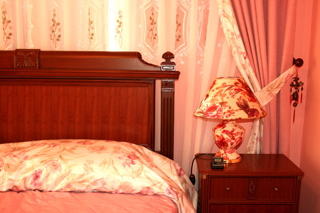 Nice red bedroom with many  luxurious details. photo
