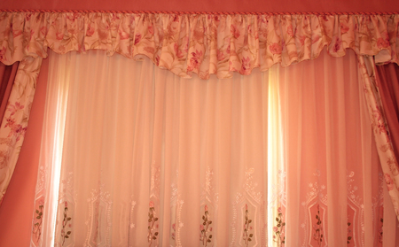 The picture of luxurious curtains  at home.