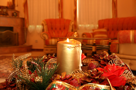Christmas still and happy life with candle. photo