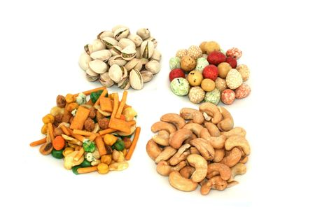 pista: Different tasty nuts isolated on the white.