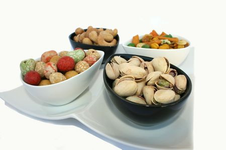 Different tasty nuts in the bowls on the white. Stock Photo - 1833611