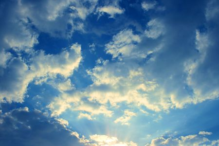 Beautiful clouds in the blue sky.Sunrise. Фото со стока
