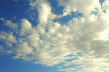 White beautiful clouds in the sunny sky. photo