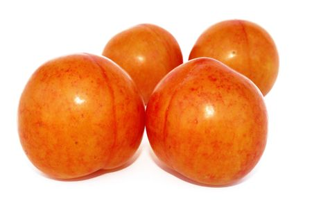 Big four plums isolated on the white. photo