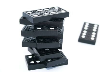 Building of dominoes isolated on the white. photo