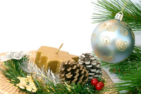 Christmas gray ball on the fir-tree and golden dish with holly-berry,cones,candle. Stock Photo - 2064741