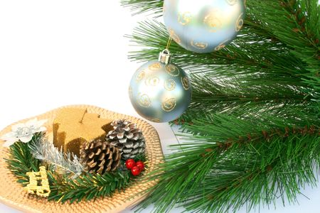 Christmas ornaments.Gray balls,fir-tree,cones,candle,holly berry. photo